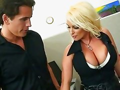 Holly Halston exposes her gorgeous globes as she rides a rampant rod