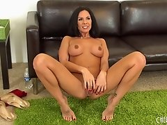 Exquisite woman with a beautiful dark hair plays with her vagina