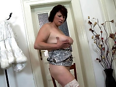 Redhead buxom amateur mature MILF Dalia strips and masturbates