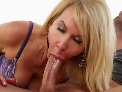 Blonde Milf hungrily engulfs tattooed guy's cock with her mouth