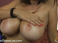 Horny MILF Charlee Chase oils up her HUGE tits!