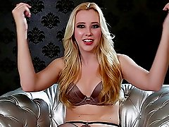 Samantha Rone gets interviewed on a couch of silver