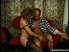 Granny rides balding man's cock