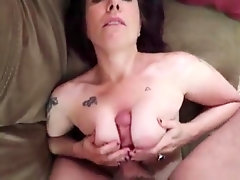 Short haired MILF amateur gives a blowjob and a titjob close up
