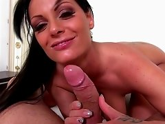 Well-endowed brunette Sheila Grant sucks a hard cock in the bathroom