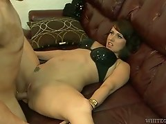 Beautiful brunette MILF is getting nailed missionary style