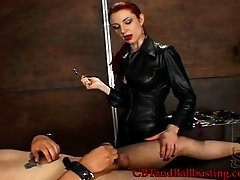 Latex-clad dominatrix with a great body playing with a stranger's cock