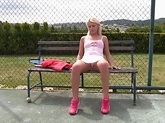 Tennis teen in a miniskirt masturbates on the court
