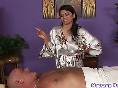 Sexy smiling brunette masseuse massage dude's body and jerks his dick