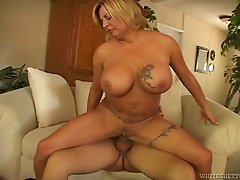 Busty and insatiable blonde cougar rides a hard dick