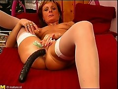 Kinky granny sticks a dildo in her twat before riding a hard cock