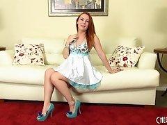 Lovely redhead Dani Jensen strips and fucks her fun toys