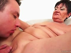 Granny groans with a cock fucking her shaved pussy