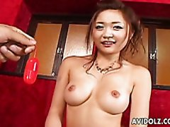 Smiling busty Japanese girlie tickles her a bit hairy pussy for some fun