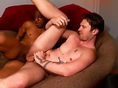 Handsome gay guy with a hot body sucking a big black cock