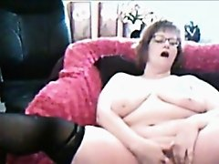 Charming granny loves fingering pussy on webcam