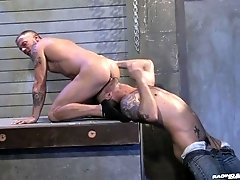 Horny lads in the dungeon pleasure each other's tight assholes