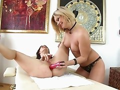 Lingerie clad lesbian hottie gets her anal spooked with a toy till orgasm