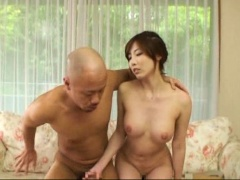 Attractive Japanese milf with perky boobs takes on two dicks