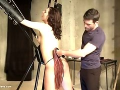 BDSM with screaming tied up slave getting whipped hard