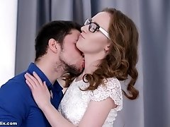 Nerdy curly haired amateur Emma Fantazy bent over a desk and fucked