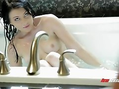 Leggy babe with long dark hair and big perky boobs getting her shaved cunt licked slowly