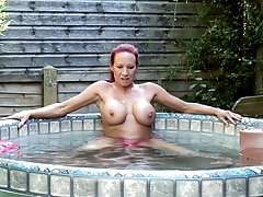 Busty mature redhead MILF Faye exposes her huge firm tits