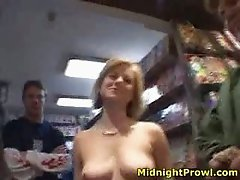 Filthy MILF Alex Devine shows off her tits at the adult videos store