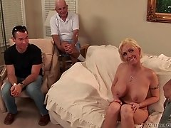 Blonde with large breasts allows the guys to watch her getting banged