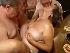 Mature sluts blow and get fucked during a wild orgy indoors