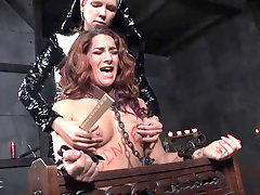 Lesbo is tied up and fucked by a horny nun