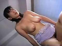 Big breasted Japanese hottie has a hard stick making her pu