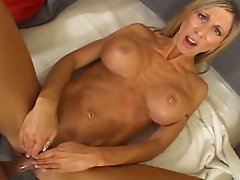 Disgusting fair haired MILF with fake ugly boobs blows big cock on camera
