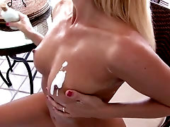 After undressing blond head Darryl Hanah plays with her creamed titties