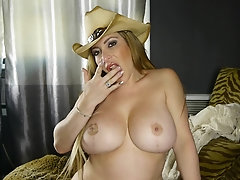 Busty blonde MILF babe Savannah Jane masturbates with a dildo at home