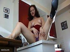 Matured cowgirl in high heels showcasing her nice ass before masturbating