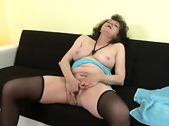 Mature amateur curly haired Harrietta shaves her hairy pussy clean