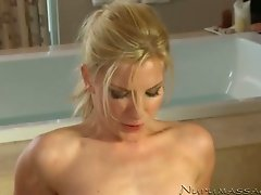 Pale skinned blonde masseuse gives outstanding massage naked