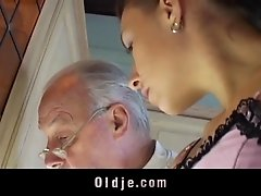 Brunette licks oldman all over his sere skin and fucks him