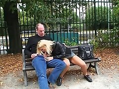 Horny couple gets into public sucking and licking on a park bench